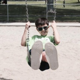 Young boy swinging